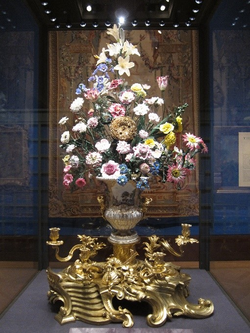 The-restored-porcelain-sunflower-clock-–-Painting-Paradise-Exhibition-Buckingham-Palace